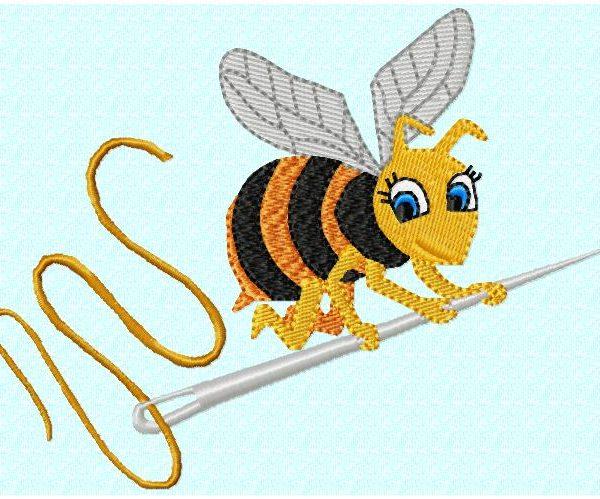 motif de broderie machine abeille sur une aiguille