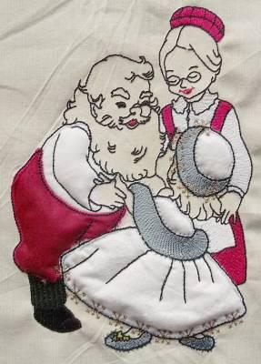 motif de broderie père noël avec une petite fille