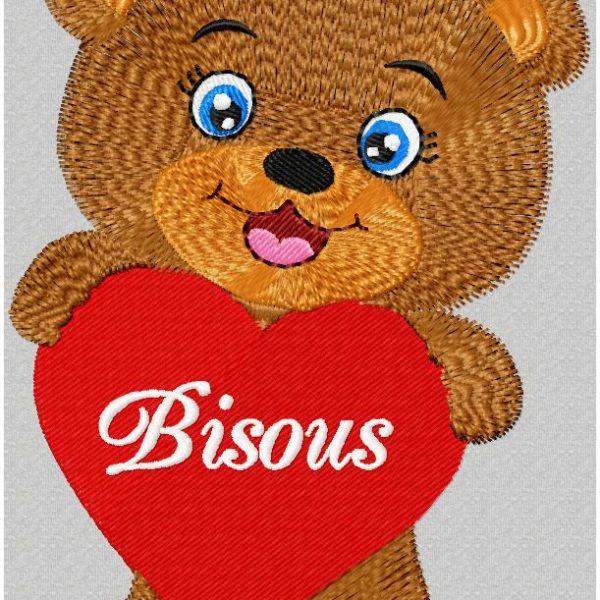 petit ours et son cœur motif de broderie machine redwork