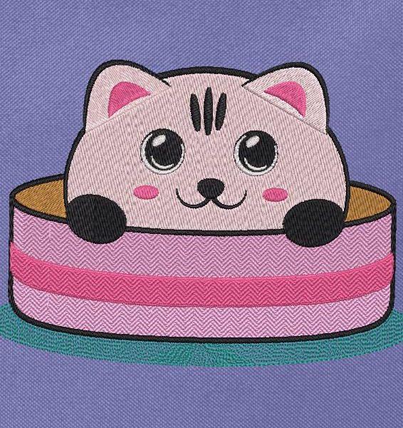 chaton mignon dans sa boîte à chapeau motif de broderie machine