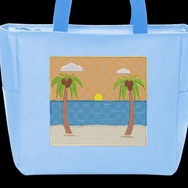 Motif de broderie machine de deux majestueux cocotiers sur la plage