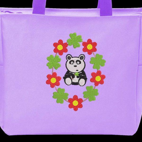 Motif de broderie machine camée panda entouré de trèfles et de fleurs