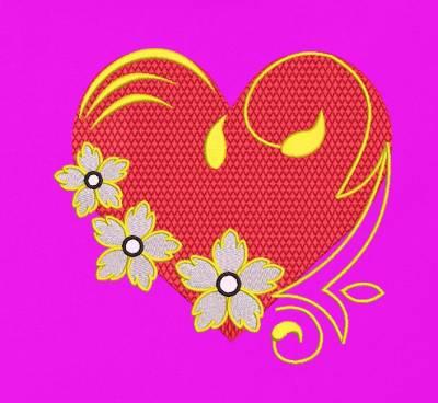 Motif de broderie cœur fleuri arabesques