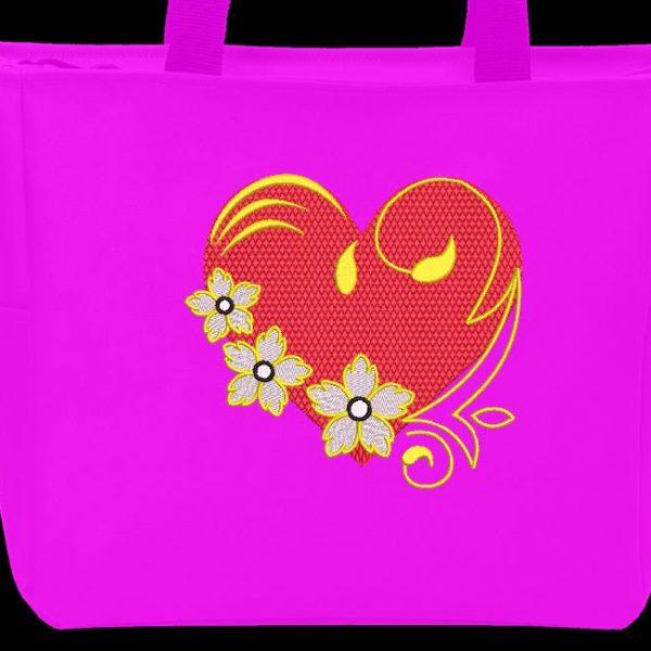 Motif de broderie machine d'un cœur fleuri avec des arabesques