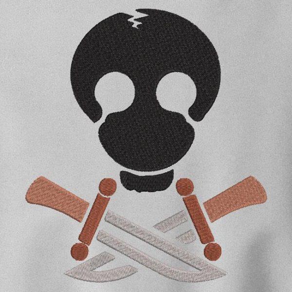 Motif de broderie machine d'un crâne avec des couteaux