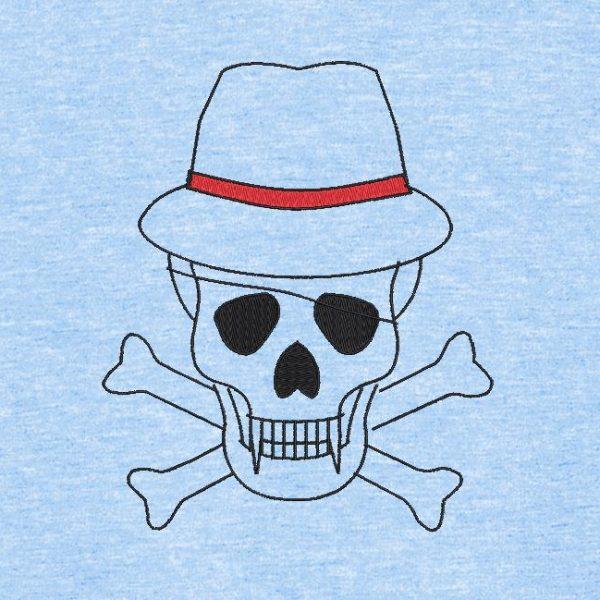 Motif de broderie machine d'un crâne avec un chapeau et un cache œil