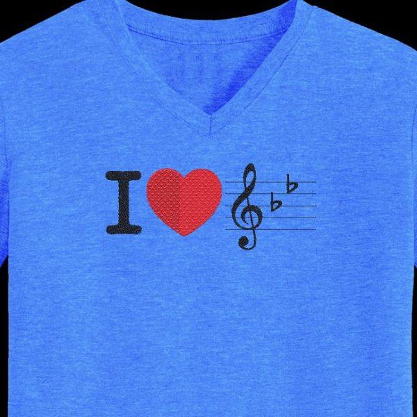 Motif de broderie machine j'aime la musique avec un gros cœur rouge
