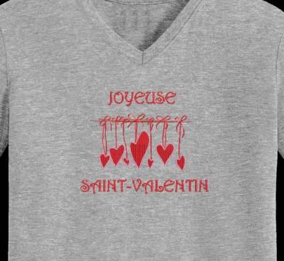 """Motif de broderie machine """"joyeuse saint valentin """" qui représente des petits cœurs rouges et roses suspendus"""