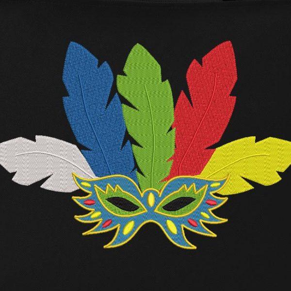 Motif de broderie machine qui représente un masque de carnaval et des plumes