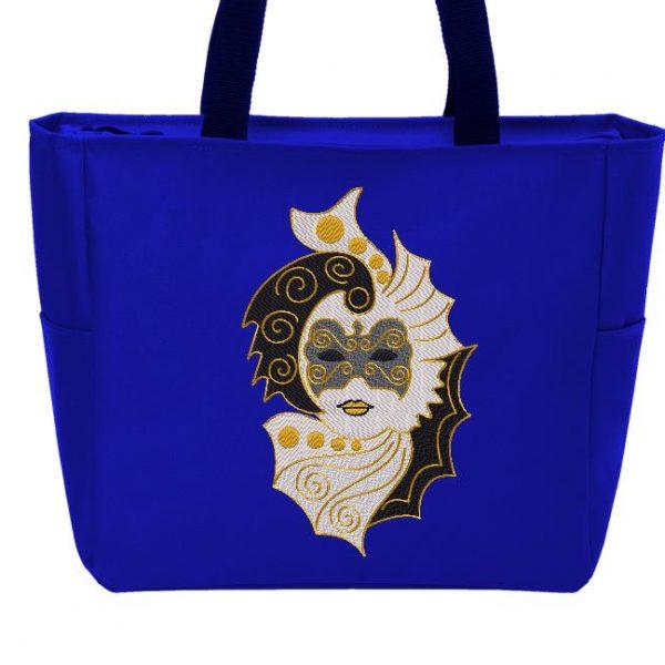 Motif de broderie machine qui représente un masque de carnaval vénitien