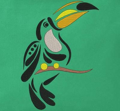 Motif de broderie machine d'une silhouette de toucan