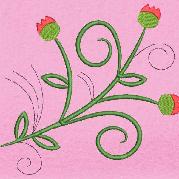 Motif de broderie machine fleurs arabesques.