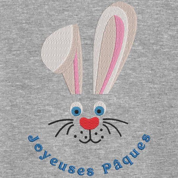 Motif de broderie machine visage lapin de pâques avec le texte joyeuses pâques