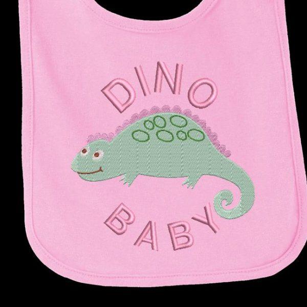 Motif de broderie machine d'un adorable petit bébé dinosaure.
