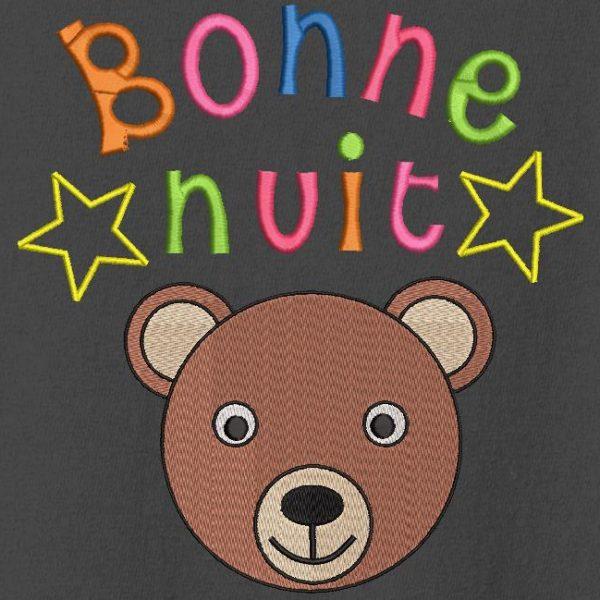 Motif de broderie machine d'un adorable ourson avec le texte coloré bonne nuit