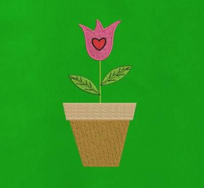 Motif de broderie machine d'une tulipe dans un pot
