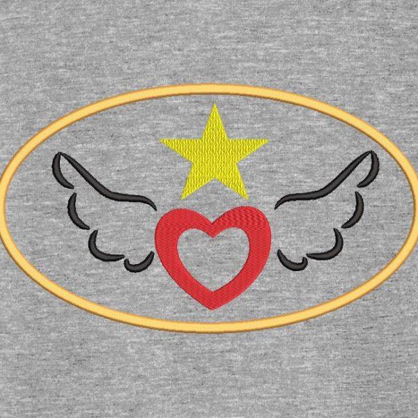 Motif de broderie machine d'un cœur avec ailes en appliqué