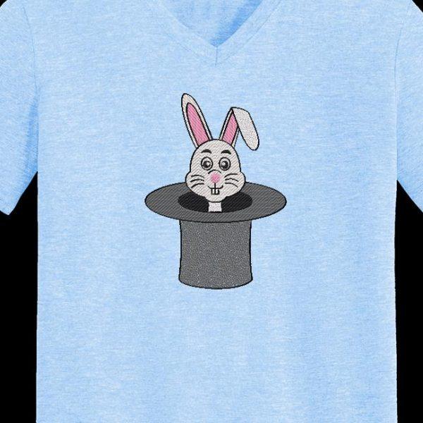 Motif de broderie machine d'un lapin dans un chapeau de magicien