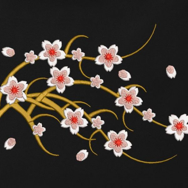 Motif de broderie machine d'une branche de cerisier en fleur .