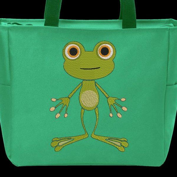 Motif de broderie d'une petite grenouille.