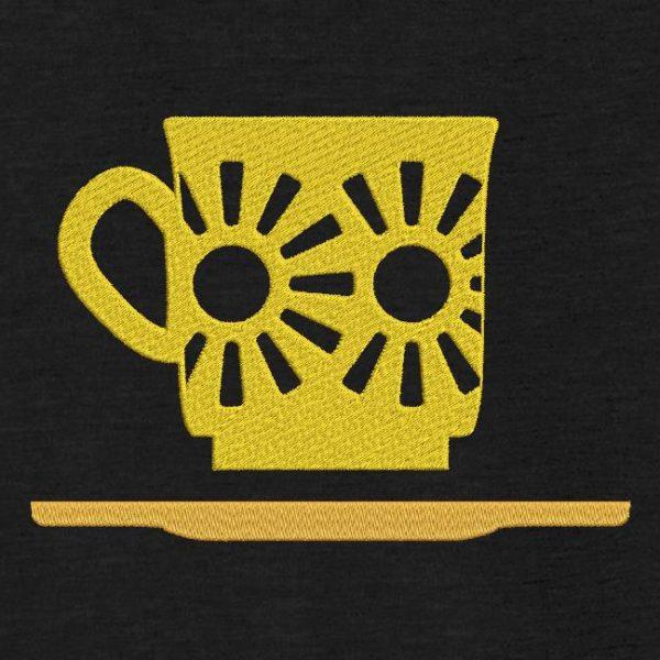 Motif de broderie machine d'une tasse vintage.