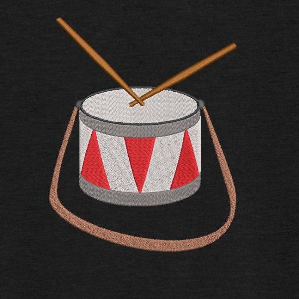 Motif de broderie machine d'un tambour.