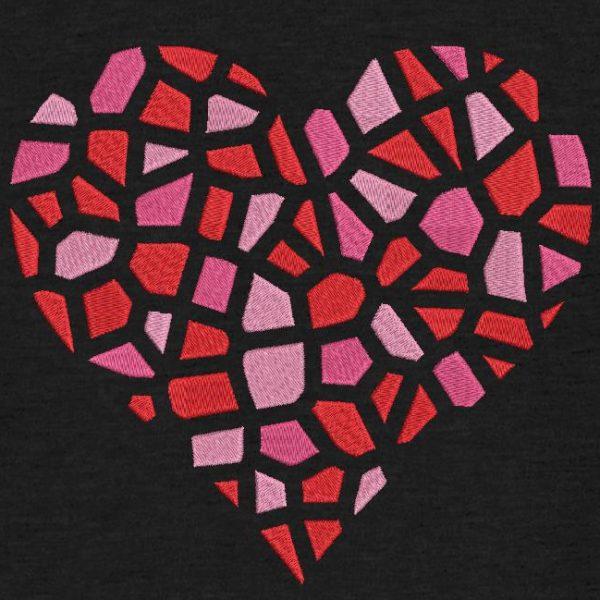Motif de broderie machine d'un cœur brisé en mille morceaux.