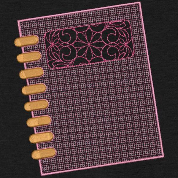 Motif de broderie machine d'un cahier à spirale.