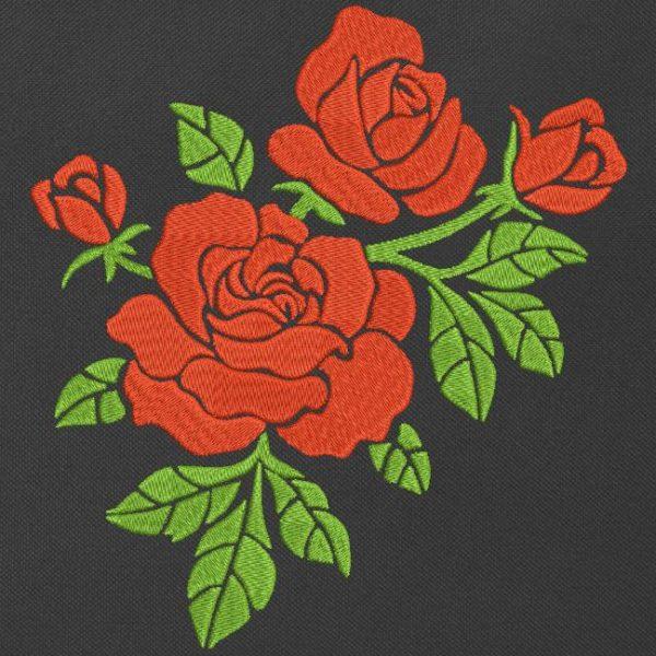 motif de broderie machine de roses rouges décoratives.
