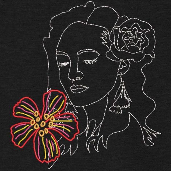 motif de broderie machine visage des îles avec une fleur.